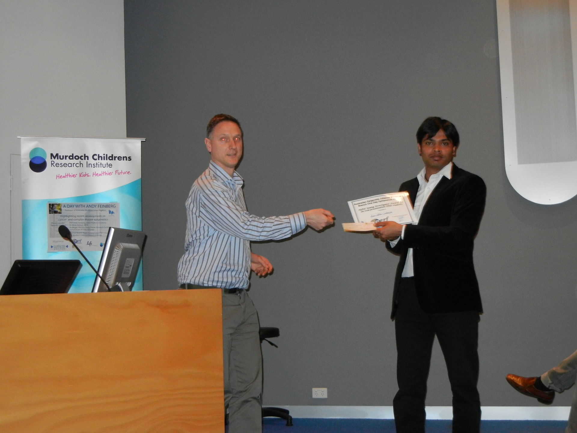 Receiving AGRF young investigator award for best speaker , Melbourne, Australia